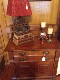 Antique side cabinet; darling bird cage lamp