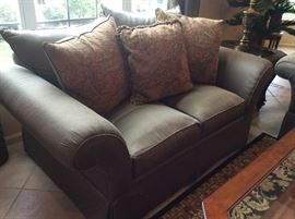 Pair of taupe love seats in pristine condition! $700 pair