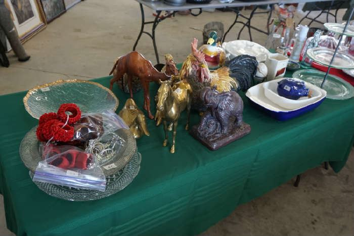 Solid brass horse, duck, elephant, what appears to be leather wrapped camel, rooster, duck soup tureen.