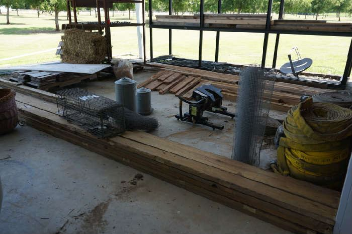 Chicken feeders, wire, fire hoses. stack of tile, metal storage rack