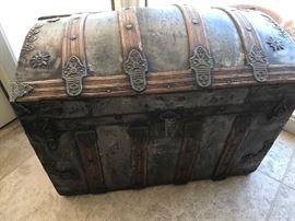 Vintage Steamer Trunk,  antique table not shown.