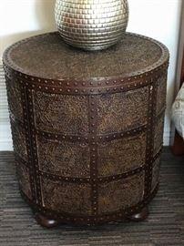 Unique nailhead table with storage.