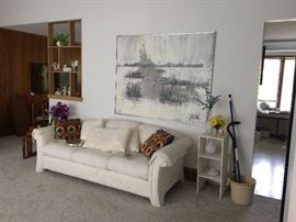 White upholstered sofa and large contemporary framed art