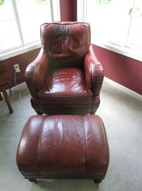 LEATHER BURGUNDY CHAIR AND OTTOMAN, ONE OF TWO