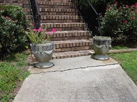 Pair of concrete planters with Greek key design and garlands