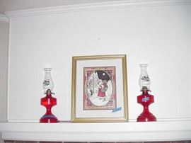 Christmas print; oil lamps with red bases and Christmas holly decorated hurricanes