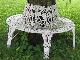 Cast iron bench surrounds a tree - 2 of these