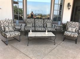 Cream and black upholstery on this patio suite