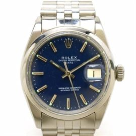 Rolex Date Stainless Steel Wristwatch with Box: A Rolex Date Stainless steel linked wristwatch featuring a blue dial with a magnified calendar window. Watch includes its display case and box.
