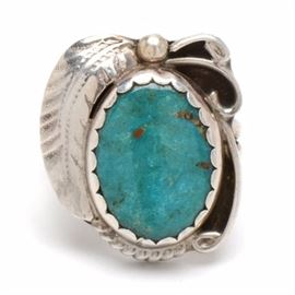 """Signed Native American Hopi Sterling Silver Turquoise Ring: A signed sterling silver and turquoise Native American Hopi turquoise ring by artisan Caroline Tawangyama. This size 6 ring features a large turquoise cabochon with scrolled embellishments to one side and a feather to the other side. Marked to the inside is """"CT 925"""". The total approximate item weight is 0.230 ozt, inclusive of all materials."""