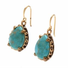"""Barse Brass Turquoise Dangle Earrings: A pair of Barse designed brass and turquoise dangle earrings. These pear shaped turquoise stone earrings are bordered by foliate designs. To the versos, they are marked, """"Barse Thailand""""."""
