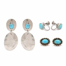 """Signed Navajo Marie Smith Sterling Silver Turquoise Earrings and More: A pair of sterling silver pierced dangle earrings by Navajo silversmith/jeweler Marie Smith. They feature bezel-set stabilized turquoise cabochon stones. They are marked to the verso, """"Sterling S"""". Also included is a pair of sterling silver stud earrings with round cabochon turquoise stones, and a pair of screw back earrings with oval cabochon stabilized turquoise stones. The overall weight for the lot is 0.465 ozt."""