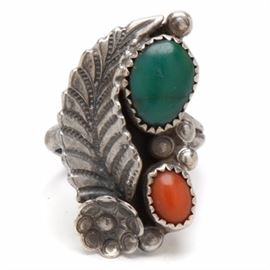 """Sterling Silver Turquoise and Coral Ring: A sterling silver turquoise and coral ring. This Native American style ring is a size 6.50 and features teardrop-shaped turquoise and coral stone cabochons embellished by a feather and flower to one side. This piece is unmarked but metal type tested as """"925"""". The total approximate item weight is 0.295 ozt, inclusive of all materials."""