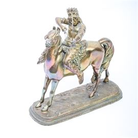 Brass Sculpture of Native American Riding Horse: A detailed brass sculpture depicting a Native American on horseback. This vintage cast piece is unsigned is has a felt base.