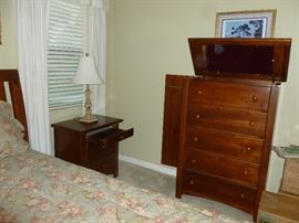 Dresser has top with mirror for jewelry and side opens for belts