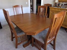 Mission style Dining room table with two leaves, 6 chairs, gear system with lock close.....antique buffet not for sale