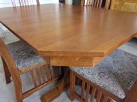 Mission style Dining room table with two leaves, 6 chairs, gear system with lock close