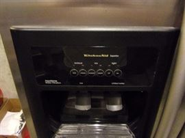 KitchenAid side by side stainless steel refrigerator with ice/water dispenser