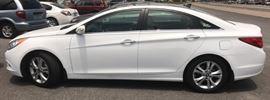 2013 Hyundai Sonata with 18k miles  Title will be here next week, as this was a estate being settled the DMV is taking their time. But you will receive a bill of sale as soon as you buy it so you an take it home.  Unless you pay by check, we wait for the check to clear.