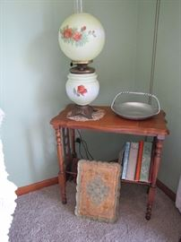 Cool antique book shelf with a Gone with the Wind lamp