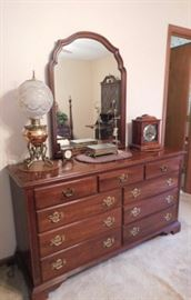 Electric Hurricane lamp,Seth Thomas mantel clock,Knob Creek dresser with mirror 5 foot by 3