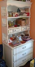 White dresser with hutch, crafts, books