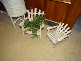 Two child-size adirondack chairs.