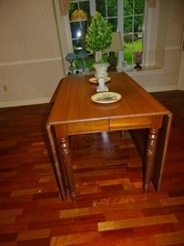 Cherry drop-leaf table with two leaves & table pads.