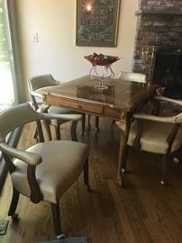 Game table and four leather chairs