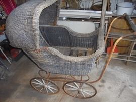 Full size antique wicker baby buggy
