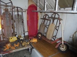 Vintage sleds, scooter and some tonka toys