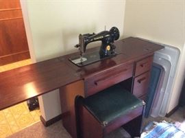 1950 's era Singer sewing machine and cabinet