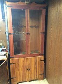 Glass front gun cabinet with storage