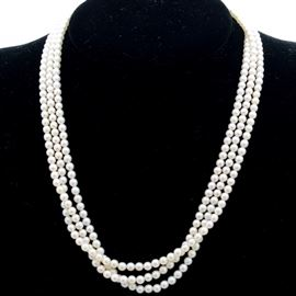 """Mikimoto Twisted Pearl Strand: A Mikimoto twisted pearl strand necklace with silver clasp. The 16.00"""" necklace features three twisted strands with hallmarked silver clasp."""