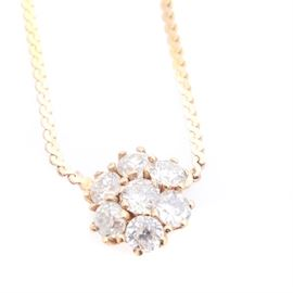14K Yellow Gold Diamond Pendant Necklace: A 14K yellow gold 0.75 ctw diamond pendant necklace.