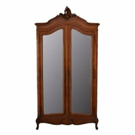 Louis IV Carved Walnut Armoire: *A Louis IV carved walnut armoire. The armoire has beveled mirrors and four adjustable shelves. It is circa 1880. I has an ornate top and cabriolet legs.