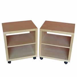 Contemporary Maple Nightstands With Shelves: A pair of contemporary maple nightstands. Each nightstand has an open front and back with an adjustable shelf between. They rest upon black plastic casters. See coordinating item 17BAL027-003.