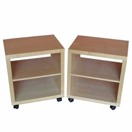 Contemporary Maple Nightstands With Shelves: A pair of contemporary maple nightstands. Each nightstand has an open front and back with an adjustable shelf between. They rest upon black plastic casters. See coordinating item 17BAL027-004.