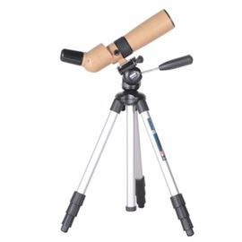 """Celestron SS60 Telescope: A Celestron SS60 telescope. This telescope features a beige and black telescope and an adjustable silver-tone metal Manfroto #390 tripod stand. The telescope is marked """"Celestron SS60."""""""