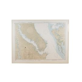 Oversize Framed Nautical Chart of Chesapeake Bay: A framed nautical chart of the Chesapeake bay. This large offset printed map depicts the Patuxent River and vicinity, and features detailed listings of water depths. It is presented under glass with a metal frame with a hanging wire mounted to the verso.