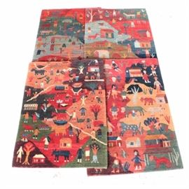 Hand Made Door Mats from Nepal: A collection of door mats from Nepal. This assortment contains four handmade mats that feature scenery of people in small farms or villages. The maker's tags are present on the verso edge of the pieces.