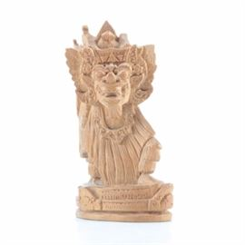 Southeast Asian Carved Wood Figurine: A Southeast Asian carved wood pe sia figurine. This depiction of a Chinese-origin religious and cultural motif, in the form of a chimerical beast, is carved in close detail, possibly in sandalwood. It is presented on a wood base that is part of the original wood block. The piece is unmarked.