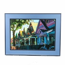"Shelby Keefe Offset Lithograph ""Colors of a Denver Neighborhood"": A Shelby Keefe offset lithograph on paper titled Colors of a Denver Neighborhood. The piece depicts a street view of a row of colorful bungalows. It is signed ""Shelby"" within the plate to the lower right margin. This print is presented matted behind glass, and framed with a wire hanger affixed to verso."