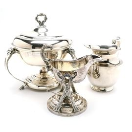 """Three Silver Plated Hollow-Ware Serving Items: A group of silver plated hollowware items, to include: a round chafing dish with burner, unmarked; a gravy or sauce boat on stand with burner, unmarked; a pitcher, marked """"Meridian S.P. Co., International S. Co.""""."""