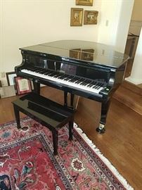 Black lacquer Wurlitzer baby grand piano and stool