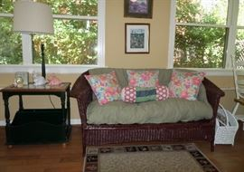 nice old wicker loveseat & a table w/lamp & magazine rack