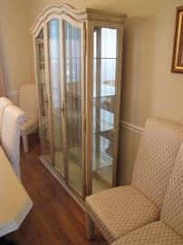 Dining room china cabinet with glass shelves. Light wood.