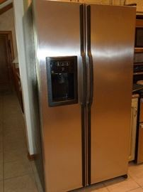 GE Stainless steel side by side refrigerator with water/ice dispenser