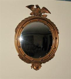 Gold gilt bull's eye mirror