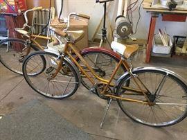 pair of vintage Schwinn bicycles, partially restored